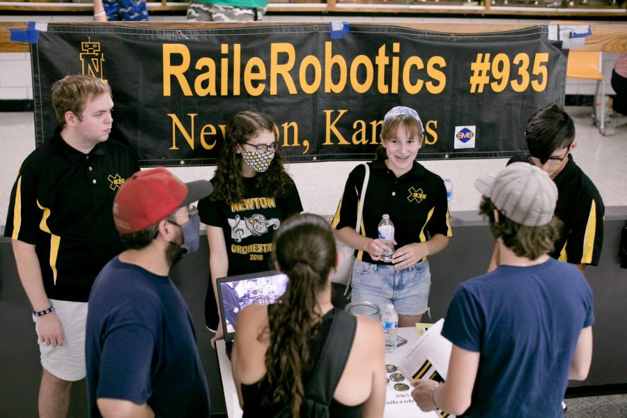 Discussing particulars of their program, students from the RailerRobotics group present to a crowd at Railer Palooza, hosted in the NHS commons on Aug. 11.