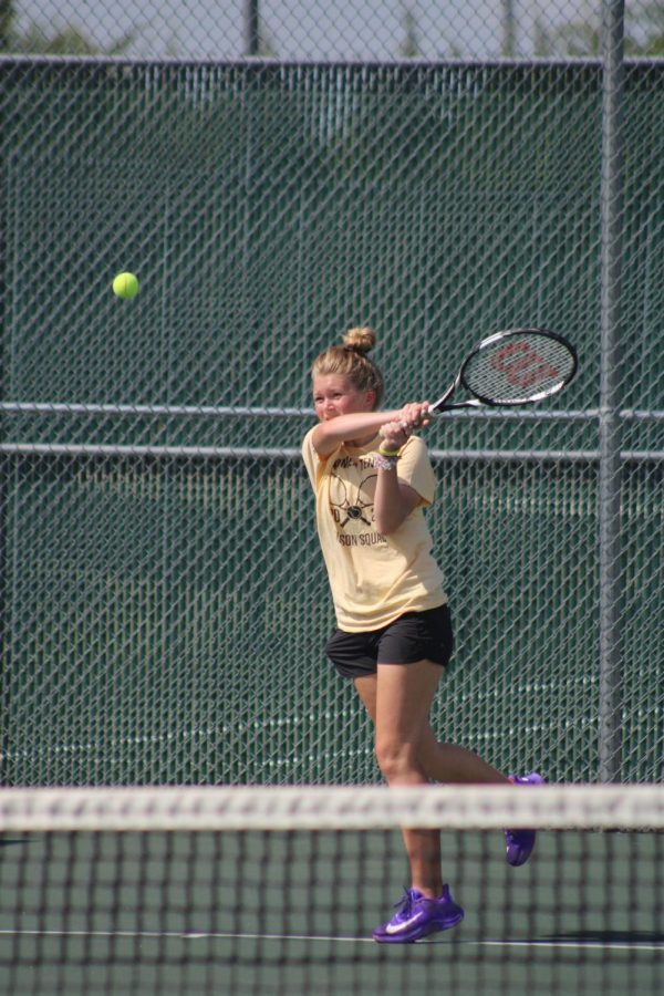 Sophomore Lucy Buller returns a shot from her opponent in the ladder tournament quarterfinals.