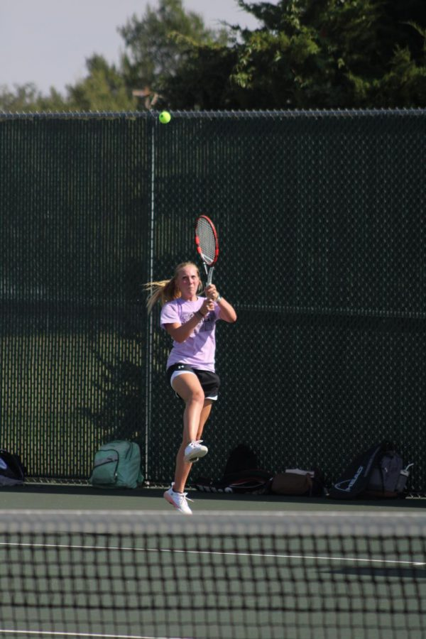 Senior Madelynn Hamm Jumps up to block a ball hit from her opponent in the ladder tournament.