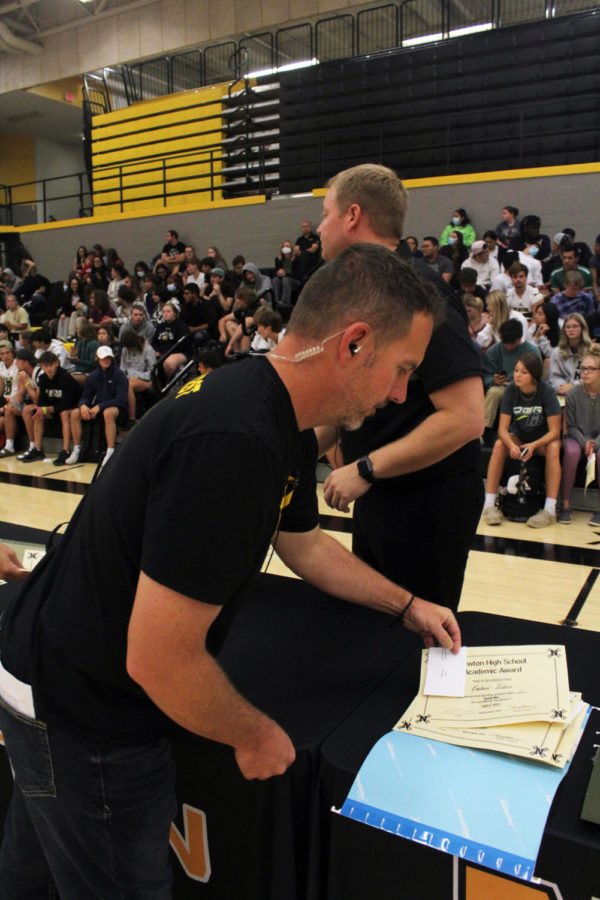 Assistant principle Derek Bristol puts aside the academic awards for the students who were absent or unable to attend the meeting.