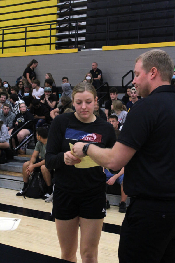 Senior Hayley Loewen receives her gold pin for letting with a 3.9-4.0 for the 2020-2021 school year.