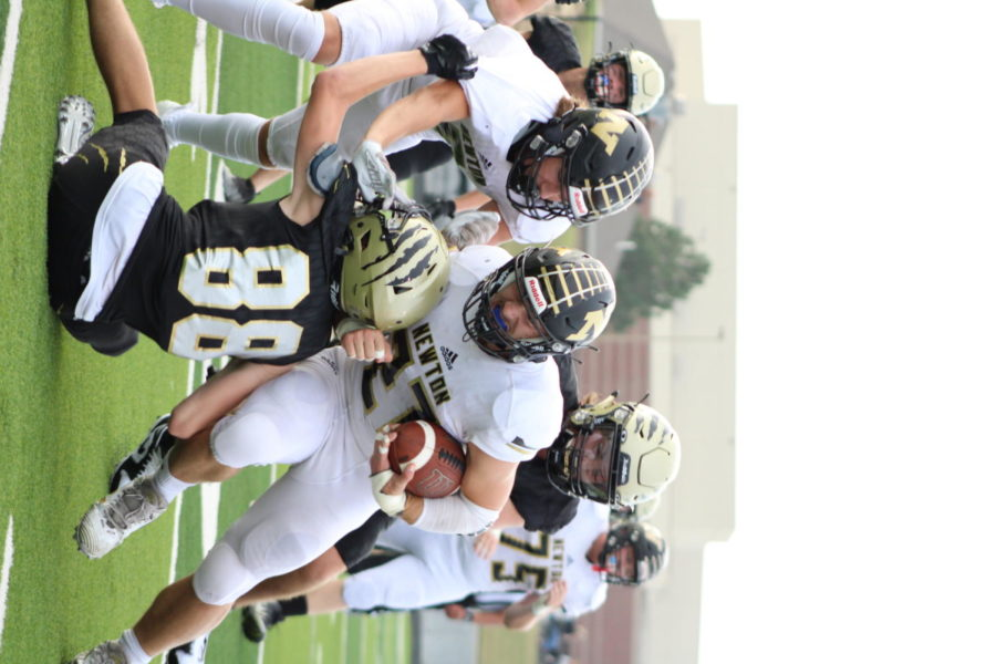 Senior Kenyon Forest pushes through the defense for a first down.
