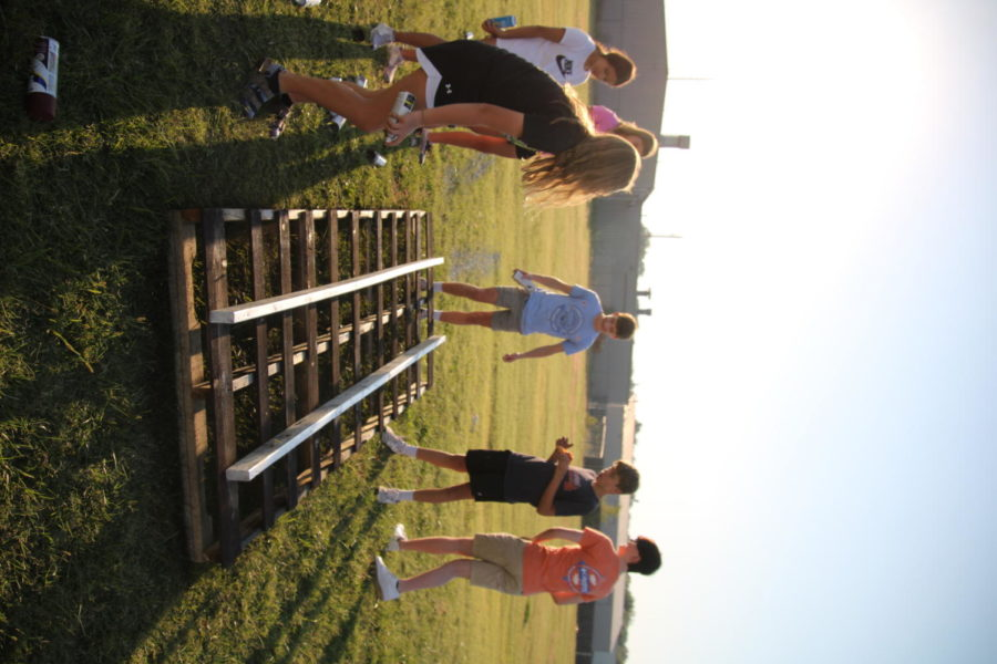 Freshman work together to make train tracks for their float.