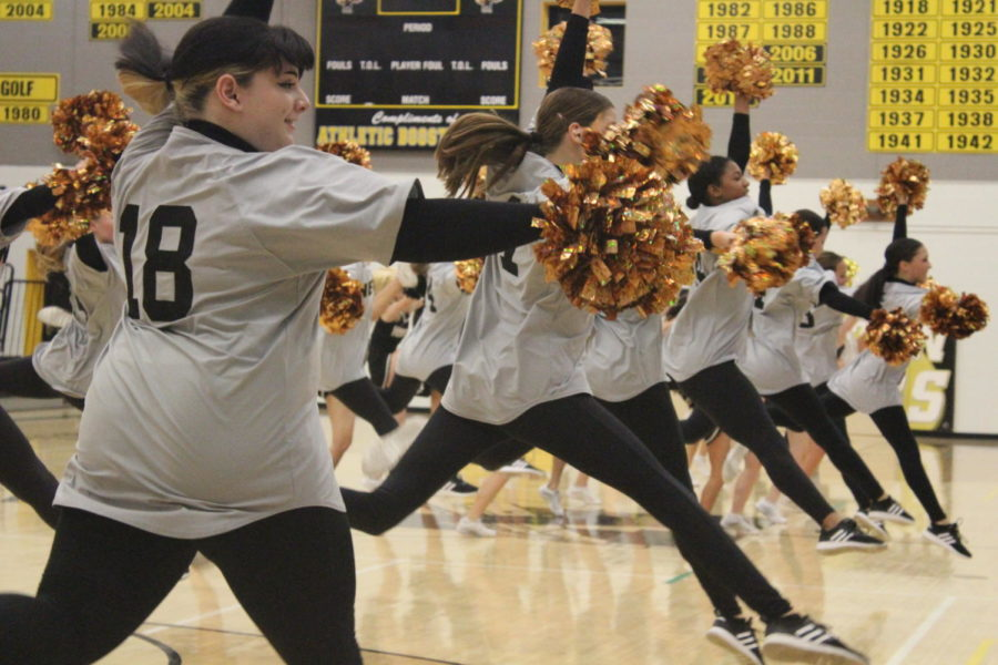 With their pompoms high in the air, Railiners leap as part of their dance