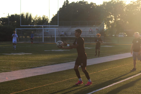 Senior Daniel Gonzalez is throwing the ball into play after the ball went out of bounds by Andover.