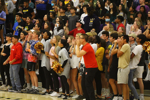 Participating in the first pep rally, the senior class yells words of encouragement at their fellow classmates during the game hosted by the cheer team.
