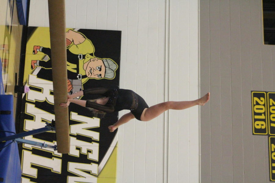 Doing a back walkover on the beam freshman Abbigale Steinert performed her beam routine.