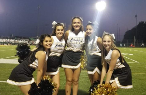 Prior to the addition of the teams new members, JV cheerleaders pose for a quick picture on Sept. 13.