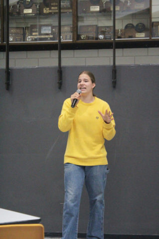 Freshman Anne Koontz sings and dance to Our Song by Taylor Swift.