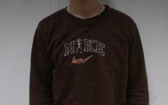 Sophomore Ian Baker wears one of Micks first creations, a handmade Nike Skeleton sweatshirt.