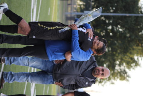 Hugging his mother on the field, Senior Darwin Maldonado is recognized at Senior Night.
