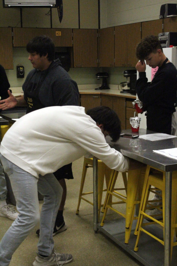 The students help keep the area clean by putting away their stools, washing their dishes, and putting them away when done.