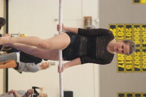 Freshman Isabella Vogt does her routine on bars.